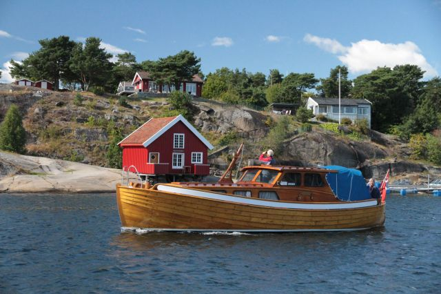 Red hut with boat