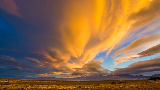 Dramatic Clouds above Plains at Sunset